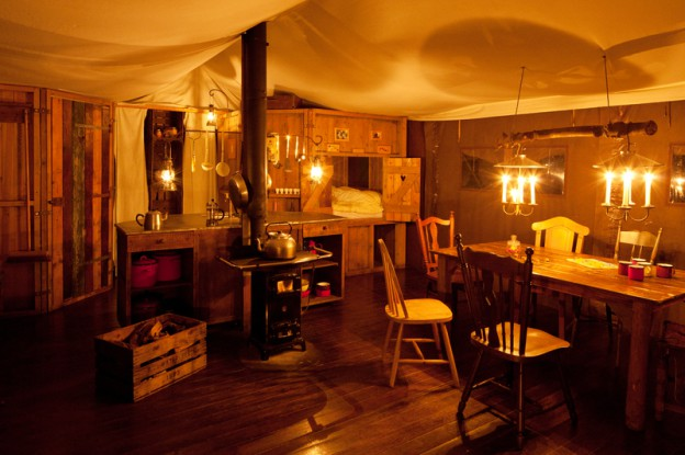 glamping-with-hot-tub-featherdown-farms-tent-interior-at-night_1
