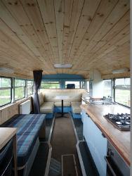 glamping-wales-ceridwen-centre-bus-interior-port-s