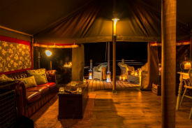 glamping-devon-longlands-safari-lodges-interior-at-night-s