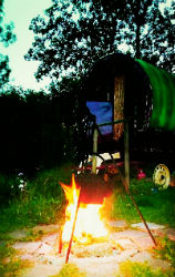 Glamping-Suffolk-Gypsy-Hollow-wagon-by-campfire